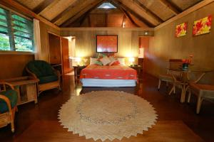 A bed or beds in a room at Muri Beach Hideaway - Adults Only