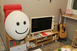 A television and/or entertainment centre at Egg House Namisum Guesthouse