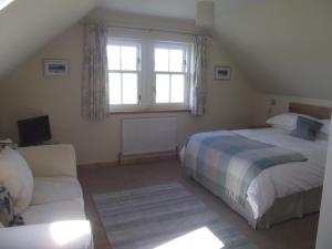 A bed or beds in a room at Ardoran House