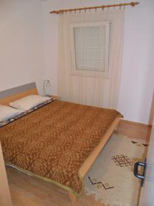 A bed or beds in a room at Apartment Kiko