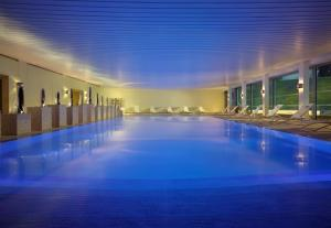 The swimming pool at or near Coworth Park - Dorchester Collection
