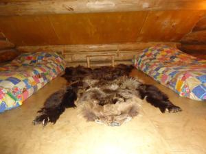 Кровать или кровати в номере Гостевой дом Алешина Изба