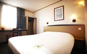 Cama o camas de una habitación en Campanile Hotel & Restaurant Amersfoort