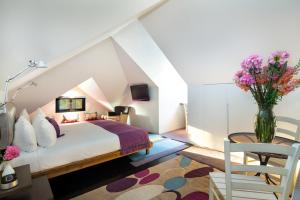 A bed or beds in a room at The Aubrey Boutique Hotel