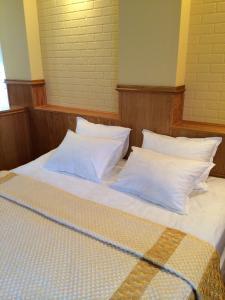 Кровать или кровати в номере Гостиница ВМ - Центральная