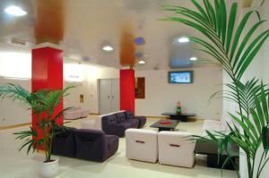 The lobby or reception area at Reginna Palace Hotel