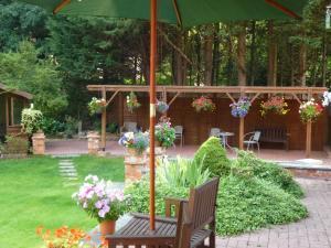 A garden outside Beech House Hotel