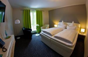 Ein Bett oder Betten in einem Zimmer der Unterkunft Hotel Eyberg