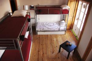 A bunk bed or bunk beds in a room at This Is Lisbon Hostel