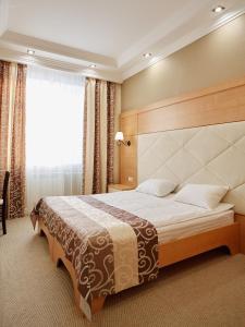 Кровать или кровати в номере Центр Отель