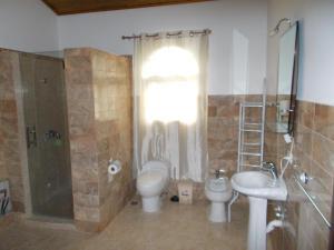 Ein Badezimmer in der Unterkunft Castillo Romano