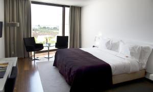 Uma cama ou camas num quarto em Pousada Palacio de Estoi – Small Luxury Hotels of the World