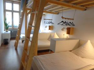 A bed or beds in a room at Minimal Hostel