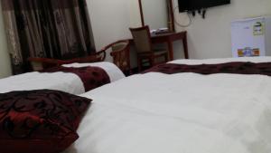 Cama ou camas em um quarto em Hana Yanbu Hotel Apartments