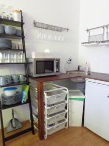 A kitchen or kitchenette at Minimal Hostel