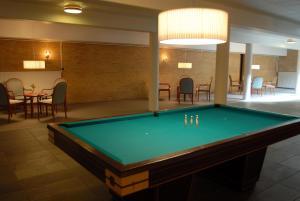 A pool table at Hotel Nørherredhus
