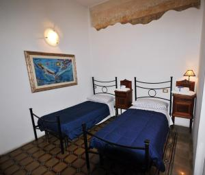 A bed or beds in a room at B&B Grand Lorì