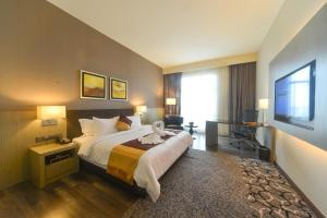 A bed or beds in a room at The Light Hotel Penang