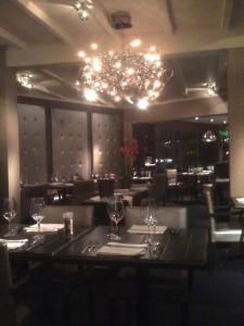 Een restaurant of ander eetgelegenheid bij De Mangerie Guesthouse Promenade