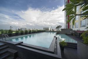 The swimming pool at or close to Grand Zuri Cikarang Jababeka