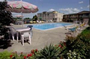 The swimming pool at or close to Days Inn by Wyndham Brockville