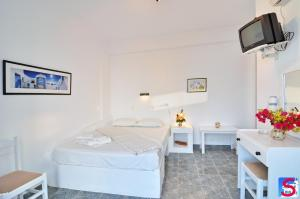 A bed or beds in a room at Soultana Rooms & Studios