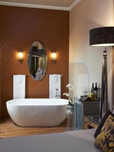 A bathroom at Aria Hotel Budapest by Library Hotel Collection
