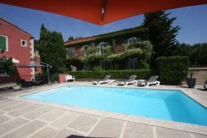 The swimming pool at or near Le Madaleno