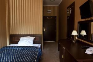 Łóżko lub łóżka w pokoju w obiekcie Shuma