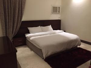 Cama ou camas em um quarto em Biyutat Jeddah - Family only