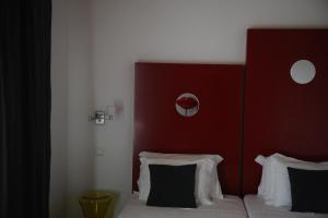 A bed or beds in a room at Naturarte Rio