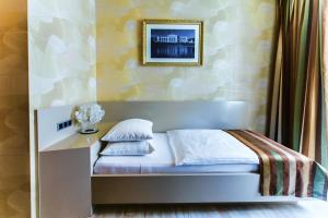 A bed or beds in a room at Hotel Prater Vienna