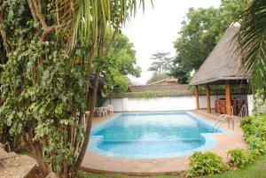 The swimming pool at or near Kiriri Residence Hotel