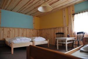 A bed or beds in a room at Agroturystyka Kociewiak