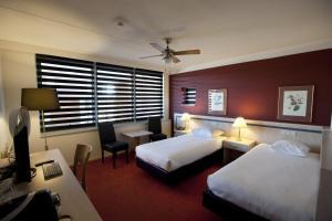 Een bed of bedden in een kamer bij City Hotel Restaurant Stadskanaal