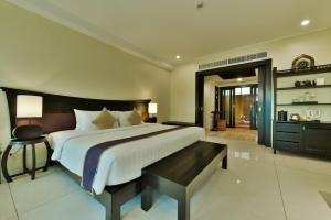 A bed or beds in a room at Bhu Nga Thani Resort & Spa - SHA Plus
