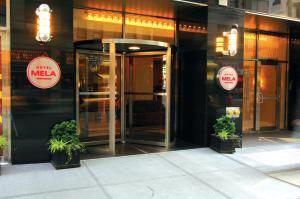 The facade or entrance of Hotel Mela Times Square
