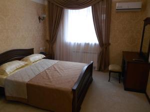 Кровать или кровати в номере Гостиница Янтарь