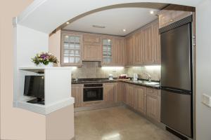 Una cocina o zona de cocina en Palm Oasis Maspalomas