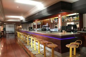El salón o zona de bar de Hotel Arcipreste de Hita - Adults Only