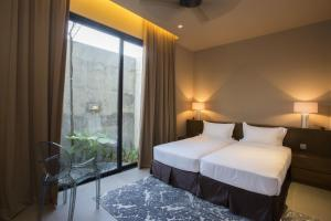 A bed or beds in a room at Silalima