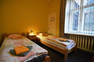 A bed or beds in a room at Hotel Multilux