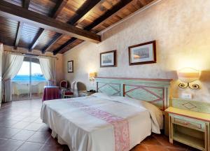 Cama o camas de una habitación en Colonna Resort