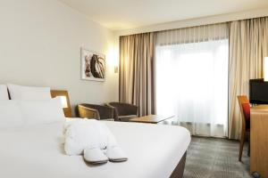 Een bed of bedden in een kamer bij Novotel Gent Centrum