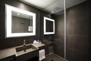 Een badkamer bij Novotel Gent Centrum