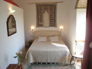 A bed or beds in a room at La Casa Grande