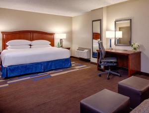 A bed or beds in a room at Wyndham New Orleans French Quarter