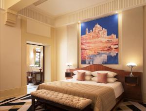 A bed or beds in a room at Umaid Bhawan Palace Jodhpur