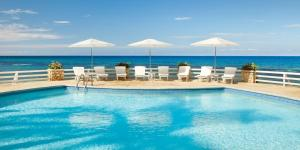 The swimming pool at or near Couples Sans Souci