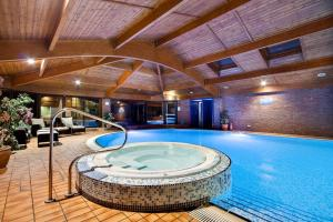 The swimming pool at or near Lea Marston Hotel
